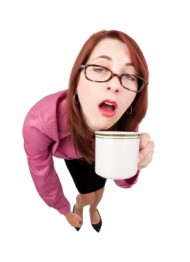 Half Asleep Woman With First Cup of Coffee